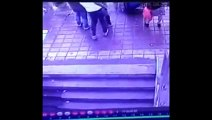 CCTV Footage   Sinkhole Swallows Pedestrians Standing at Bus Stop In Harbin   Sinkhole in China