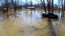 Indiana Residents Wakeboard on Ohio River Flood Water