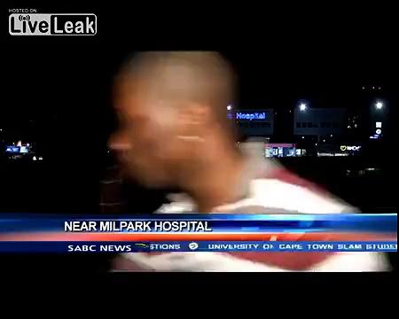 Reporter gets mugged on camera