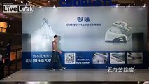 European males show off muscles to promote products in Chinese store