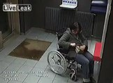 Immigrant assaulting and robbing handicapped lady in wheelchair
