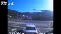 Close call for car when two trucks collide at intersection