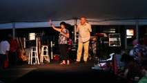 Carol Light and Dick Groeb talk to the tent crowd at Elvis Week 2015