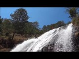 Wai's free fall/jump from 7 meters from a 25 meter waterfall. Canyoning in Da Lat - Vietnam