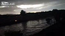 Caught on Video: Woman drives into flooded waters