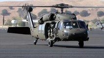 UH-60 Black Hawk helicopters and 2 CH-47 Chinooks take off in formation