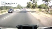Speeding driver causes accident and one really lucky cyclist