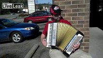 Italian Papa John's employee playing the accordion(in front of store)