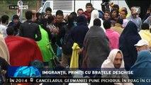 Peste 8.000 de refugiaţi au ajuns, în această dimineaţă, în Germania şi fost primiţi cu aplauze. În Munchen, localnicii i-au aşteptat pe imigranţi cu alimente şi haine.