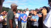 Small white rapper destroys tall black rapper in rap battle
