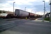 TRAIN CRASH ACCIDENT Soo 4424 freight train stops fire engine at Narragansett Ave grade crossing!!