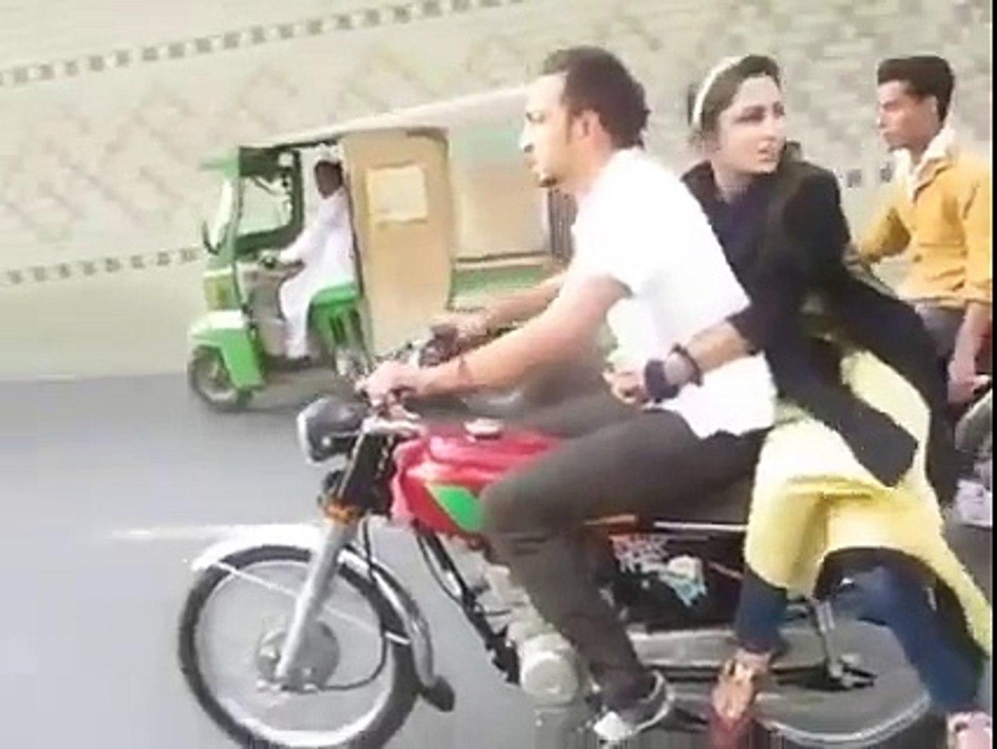 Girl and boy sitting on bike