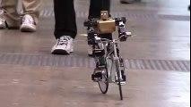 PRIMER-V2 robot rides a bike just like a man.
