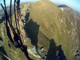 Paramotor flying along crest lines of Mont-Dore mountains