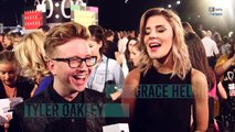 Tyler Oakley and Grace Helberg talk tongues, Miley & Nicki Minaj at the VMAS