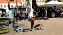 Happy by Pharrell Williams covered on a street in Vilnius
