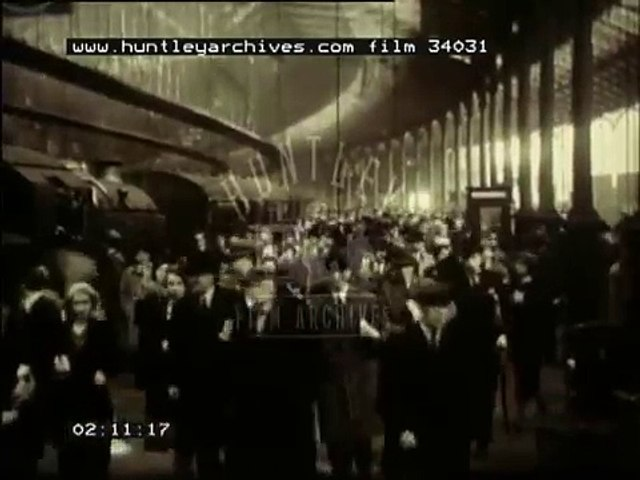1930's London railways.  Commuters and steam trains.  Film 34031