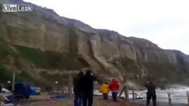 cliff collapse sussex uk and waves crashing over Aberystwyth seafront Wales storms set to get worse