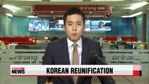 Unificaiton minister says Koreas need to work toward unification