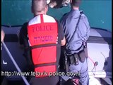 TLV (Tel Aviv) police rescue wounded Pelican from water