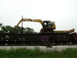 Union Pacific MOW equipment OTM Tracker machine unloading fresh ties