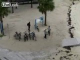 LiveLeak.com - Beach Bum Slapdown  --  Even bums can be territorialy protective