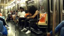 Man does crazy Air Drum performance in Subway with headbanging... Rock n Roll!