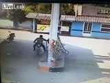 LiveLeak.com - Man on fire when motorcycle catches fire at gas station