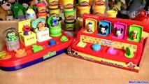 Mickey Mouse Pop Up Surprise Pals Disney Baby Toys vs. Sesame Street Elmo, Oscar, Cookie M