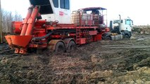 stuck in mud compilation, ever seen heavy equipment stuck in mud but the man is stucking