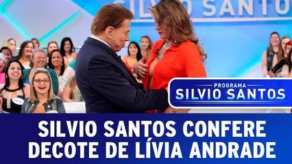 Silvio confere decote de Lívia Andrade