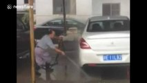 Happy car washer cleans cars with dancing martial arts moves