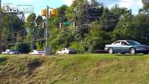 CRAZY WOMEN ON DRUGS RAMS POLICE CAR, CRASHES CAR DOWN HILL - FUNNY