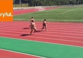 Sumo Wrestlers Sprint Down Race Track