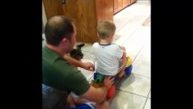 Dad Pushes Boy On Scooter, Puppy Pulls Him Back - Baby Boy And Puppy - Hahaha
