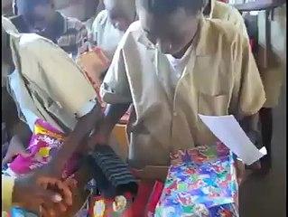 Children in Burundi Opening Donated Gifts