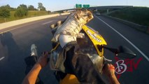 Motorcycle STUNTS Street Bike Stunt Rider Performs Long WHEELIE On Highway Riding Honda CB