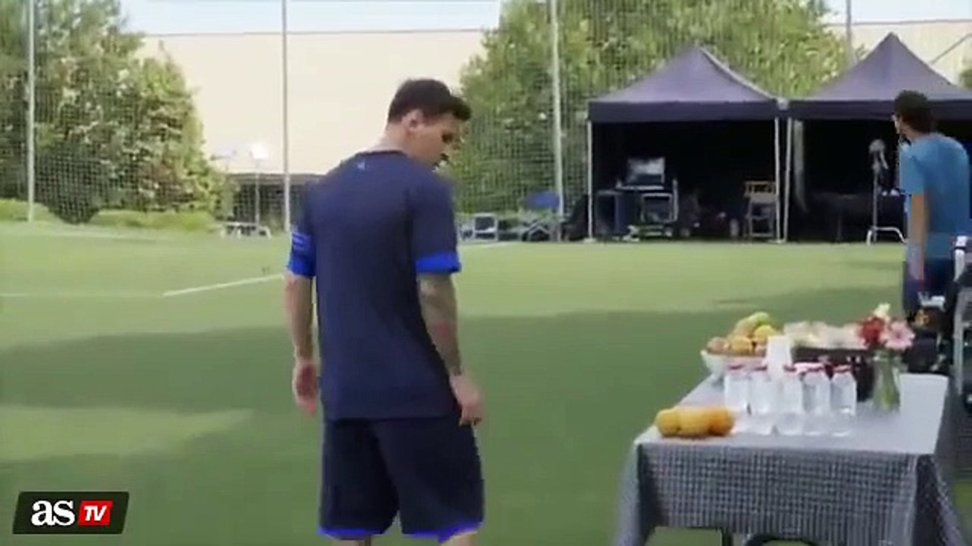 Messi doing keepy uppies with an orange