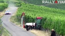 Tractor almost crashes into rally car not realising there's a race on!