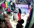 un voleur en plein action dans un magasin au palmarium20072015CAM2