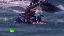 Jaw-dropping_ Surfer fights off shark attack live on TV in S. African competition