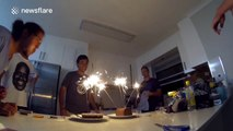 Guys wreak havoc in kitchen trying to extinguish birthday cake sparklers