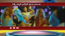 Shriya Saran lifts shirt to show navel