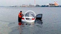 Visual kereta terbabas ke laut kerana salah masuk gear