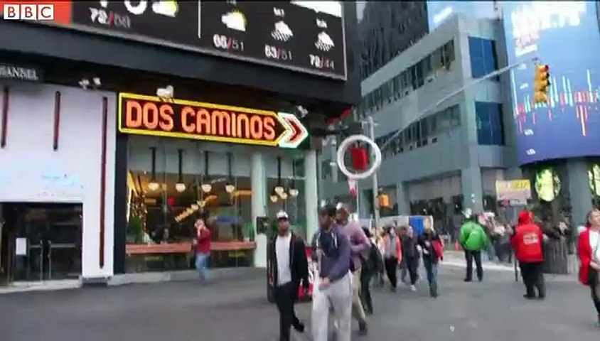 Tourists enjoy shorts weather in New York