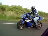 Yamaha R1 sport bike against BMW moto Unrealistic tricks during the race