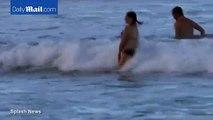 Anne Hathaway shows off pregnant bikini body with Adam Shulman
