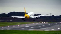 MONARCH A320 AWFUL LANDING IN STRONG WINDS & WIND SHEAR