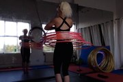 Girl Hula Hoops 7 Hoops at Once