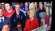 Guy with Stickers on his cheeks behind Hilary Clinton during Iowa Caucus was hilarious - #StickerKid